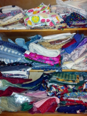 Just one of my cubbies stuffed to overflowing with fabrics collected through the years.